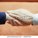 stock-photo-man-hands-holding-woman-hand-from-both-sides-compassion-and-concern-concept-193027043