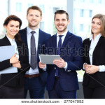 stock-photo-happy-smiling-business-team-in-office-277047992
